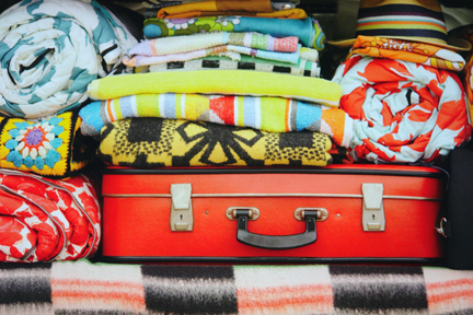 page in My Cool Campervan featuring a campervan boot full of colourful luggage and bedding