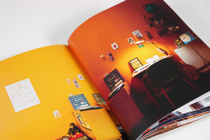 workspace with bright orange painted walls