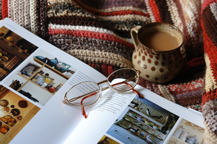pages from &quot;The Way We Live - with the things we love&quot; with mug of tea and spectacles
