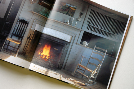 "page showing an antique chair in front of an open fire from ""The Way We Live In the Country"" by Stafford Cliff & Gilles de Chabaneix"