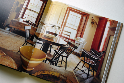 "antique wooden table & chairs with yellow pottery bowl in the foreground from ""The Way We Live In the Country"" by Stafford Cliff & Gilles de Chabaneix"
