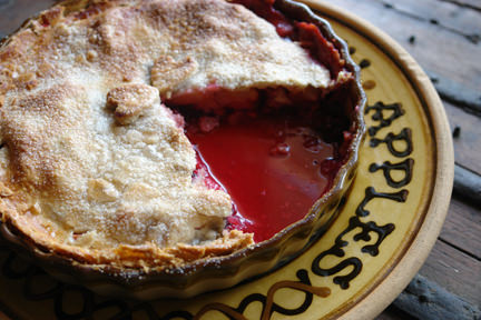 apple & blackberry pie with a slice removed