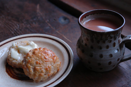 Sourdough cheese scone with a mug of tea
