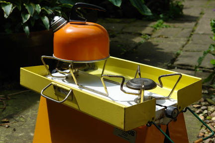 vintage yellow and orange Primus stove