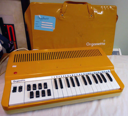 bright yellow Organetta with PVC carrier case