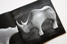 pages from a vintage craft booklet showing hand carved wooden rhino