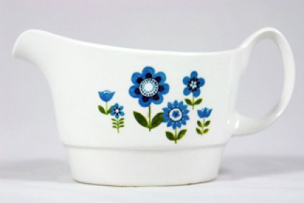 vintage gravy boat decorated with simple flower motif