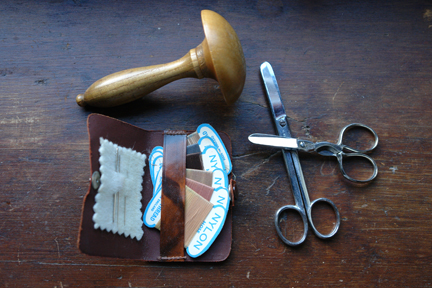 vintage darning mushroom, scissors and pocket darning kit
