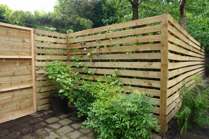 Exterior view of our new wooden garden fence