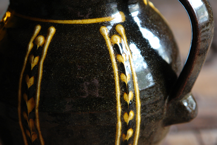 detail from slipware pottery jug by Hannah McAndrew who exhibited at Great Northern Contemporary Craft Fair 2010