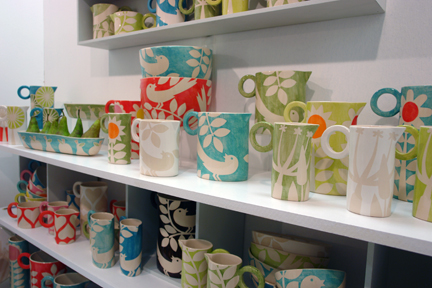 a selection of Ken Eardley ceramics on display shelves