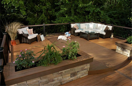 split level garden deck with seating area & raised beds