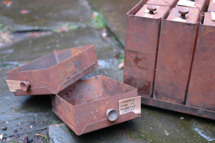 detail of small rusty industrial vintage drawers