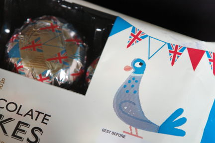 detail from Marks and Spencer chocolate teacake packaging decorated with illustrations of birds and bunting