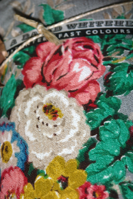 close up of vintage David Whitehead fabric with rose pattern