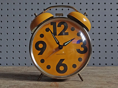 vintage orange Wesclox alarm clock