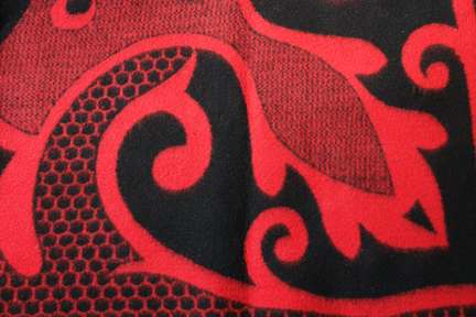 detailed view of red vintage woollen blanket