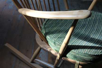 detail of a vintage Ercol beechwood rocking chair