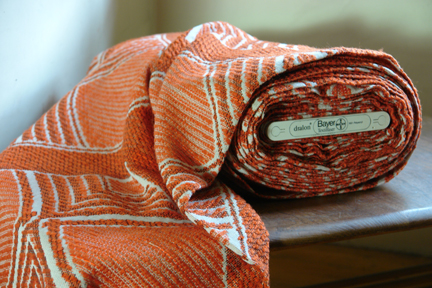 bolt of vintage orange Draylon fabric