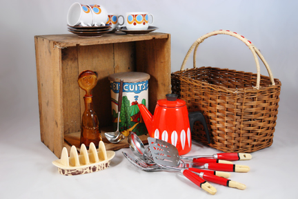 selection of recently acquired vintage shop stock for H is for Home including a red orange & white Cathrineholm Lotus enamel kettle, selection of Skyline kitchen utensils, wicker basket and Sylvac Pottery toast rack