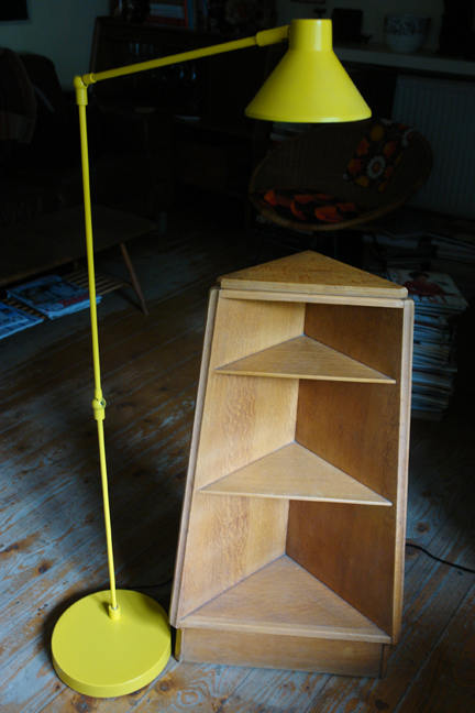 "vintage triangular corner shelf unit and bright yellow ""Bobby"" Habitat floor lamp"