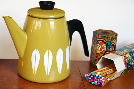vintage olive green Cathrineholm teapot and fire lighting matches with colourful tips in original hexagonal shaped, cardboard box