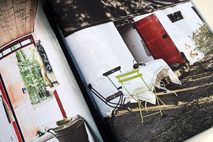 "page from the ""Artistic Idyll"" feature showing the outdoor patio area from the launch issue of Elle Decoration Country"