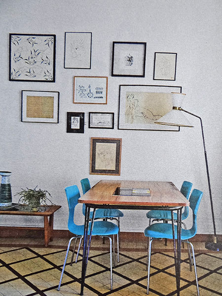 Dining table in a mid century modern decorated sitting room