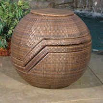 pair of rattan chairs stacked into a sphere