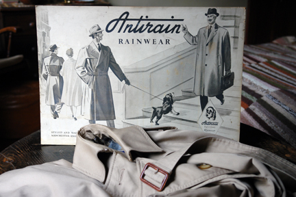 vintage shop advertising sign for Antirain Rainwear