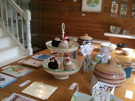 tabletop display of various art & craft items available at Snug Gallery in Hebden Bridge