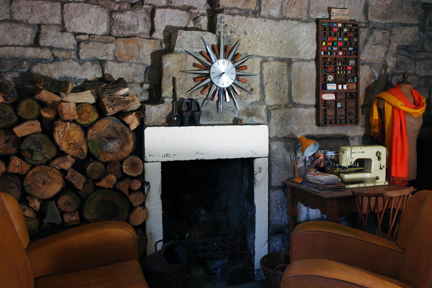 vintage Metamec starburst clock on our upstairs lounge stone wall