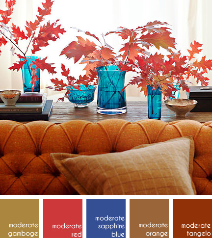 Autumn leaves in blue glass vases