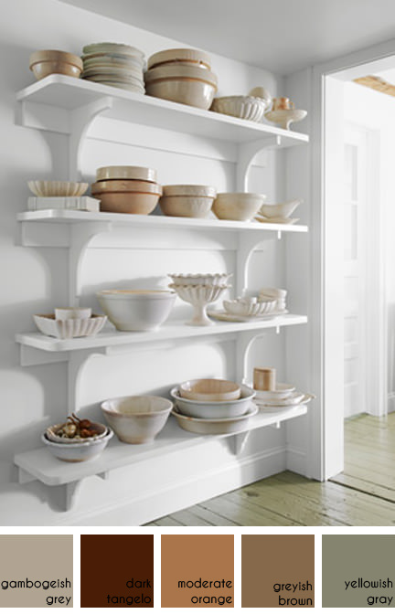 collection of pottery mixing bowls on white painted shelves