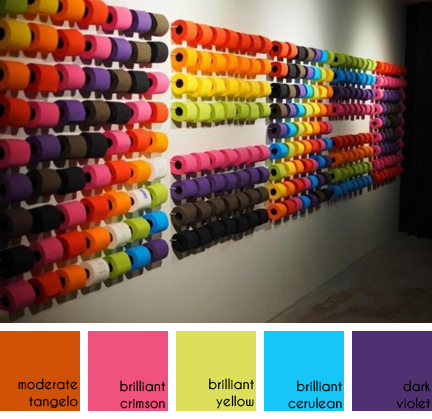 Wall of renova toilet paper in a rainbow of colours
