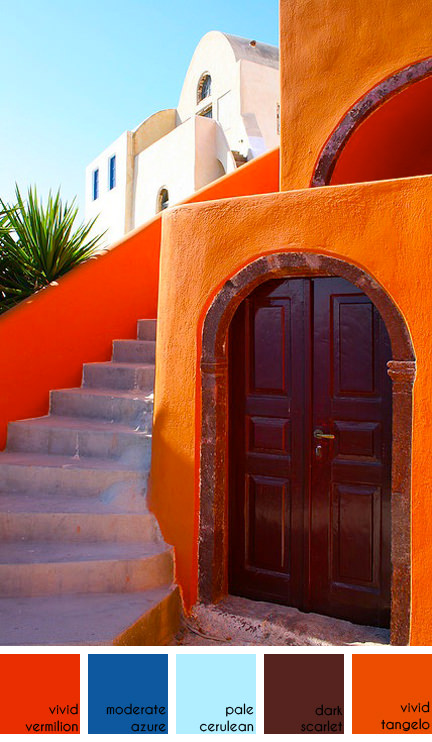 orange-painted building in Santorini