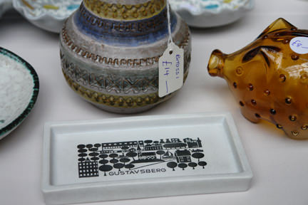 selection of vintage items on a stall including a small Gustavsberg pin dish