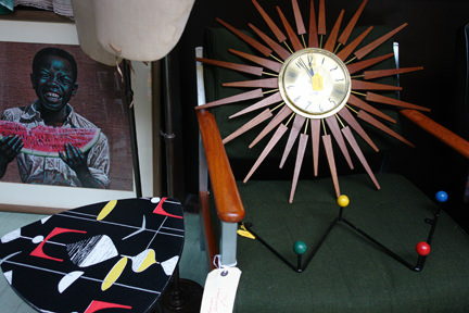 selection of mid century modern items for sale including a sunburst clock