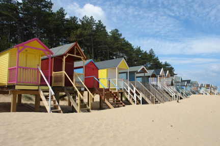 colourful beach huts on the beach between Wells-next-the-Sea and Holkham