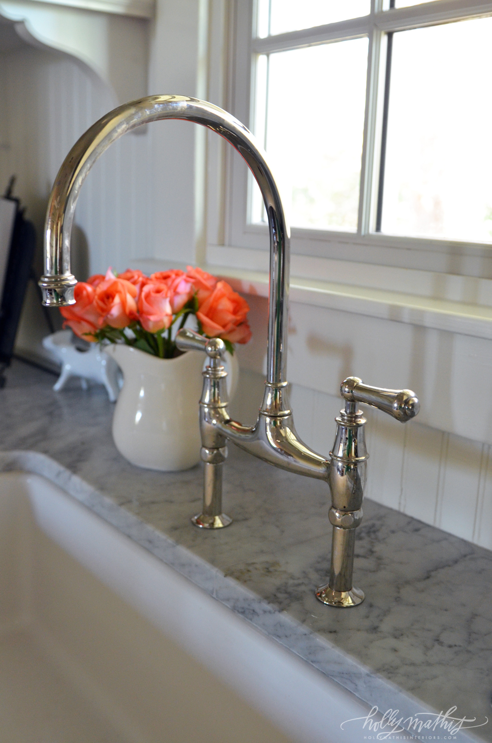 house guests louisiana farmhouse farmhouse faucet kitchen Love the stainless chrome goose neck faucet with flush mount farmhouse white sink Great close up of the marble counter tops Beadboard backsplash