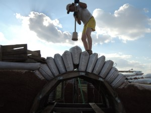 Tamping the arch bags into place.