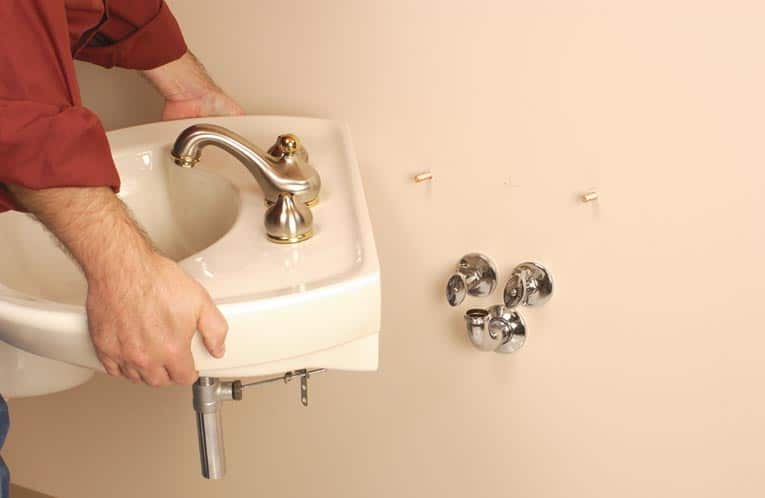 Secure The Sink Or Mounting Plate To Wall How Install Wall Mount HomeTips40