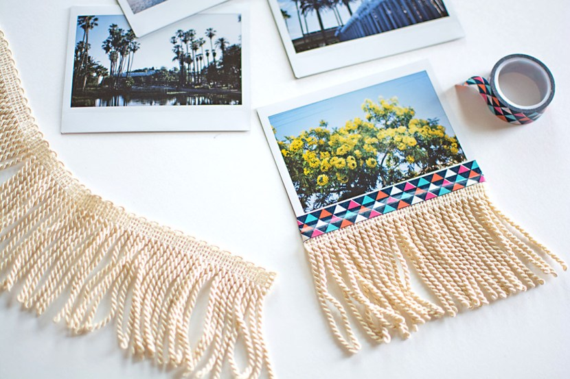 Tape fringe trim onto photos to make them more decorative!