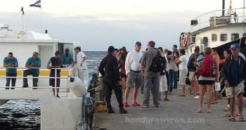 Utila Municipal Dock as Honduran Police inspect passengers of the Utila Princess in search of Captain Vern's murder suspects