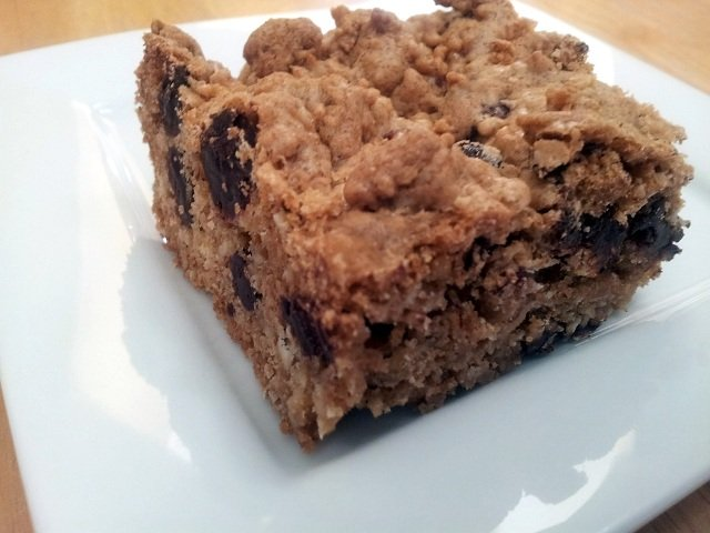 Cut chocolate chip oat bar on a plate