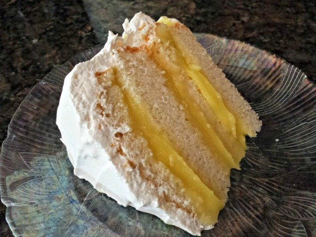 Beautiful slice of 4 layer lemon filled cake
