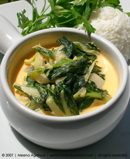 Recipe for Bok Choy in Coconut Milk taken from www.hookedonheat.com. Visit site for detailed recipe.