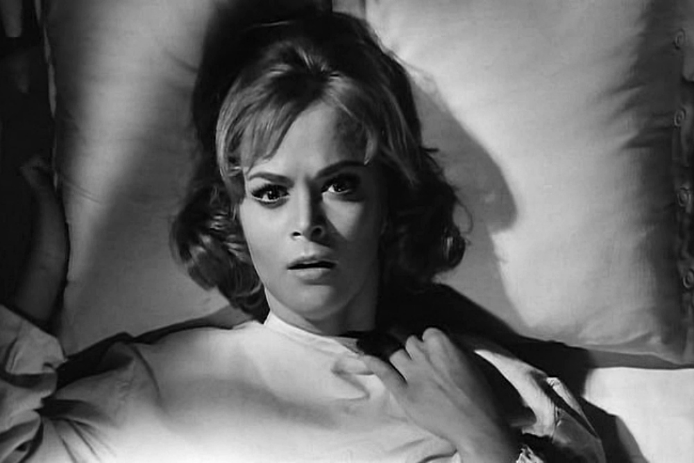 Nora (Leticia Roman), a precursor to the Final Girl, in The Girl Who Knew Too Much
