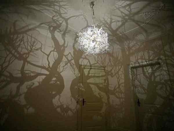 Horror Society: Chandelier Projects Spooky Shadow Forest onto Walls   www.horrorsociety.com
