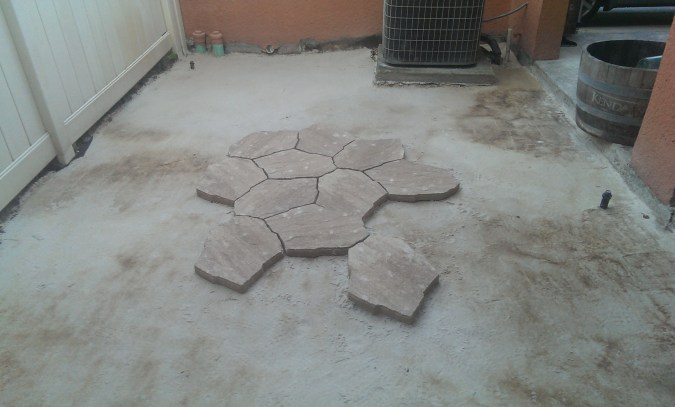 Now the real fun begins. Lifting and setting these stones, designed to look like flagstones, was a workout to say the least.